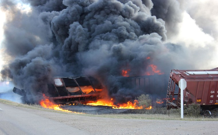 Image: A Canadian National Railway Co train that derailed near Clair Saskatchewan burns west of Wadena