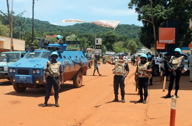 United Nations peacekeepers are seen stationed in the center of the Central African Republic capital Bangui, on October 8, 2014, following fresh violence that rocked the country leaving up to five people dead and several others wounded. The violence was sparked by an incident the day before when a motorcyclist threw grenades injuring several pedestrians in the capital, an officer from the UN peacekeeping MINUSCA force said. Further violence erupted in Bangui's KM5 district when a taxi driver was killed by Muslims who then torched several homes. Separately a group of Muslims tried to advance on the capital's northern districts but were arrested by European peacekeepers. The unrest has pitted different groups -- split along religious, ethnic and tribal lines -- against each other.