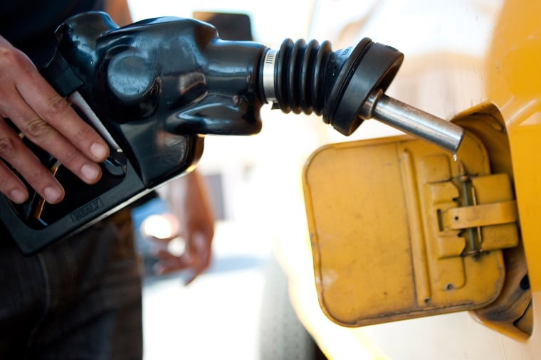A man pumps gas into at a gas station in Los Angeles on Aug. 10, 2012.