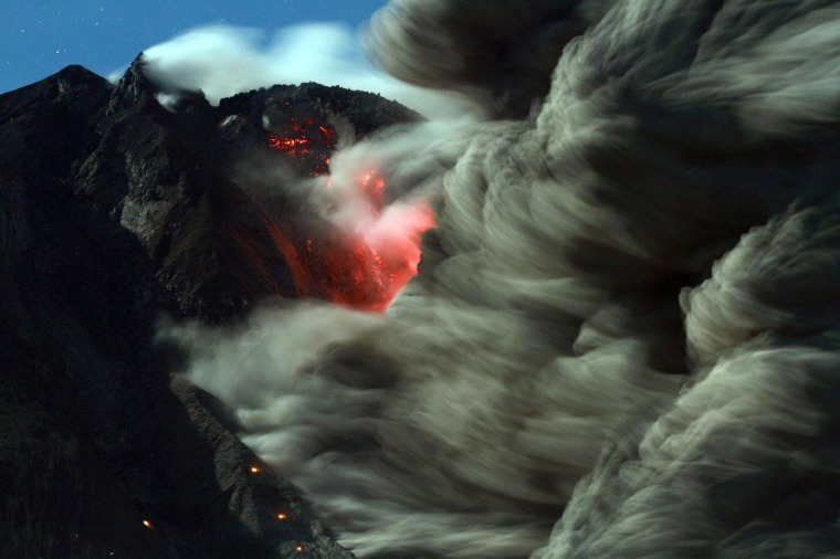 Mount Sinabung spews hot lava and volcanic ash in North Sumatra, Indonesia, 09 October 2014.