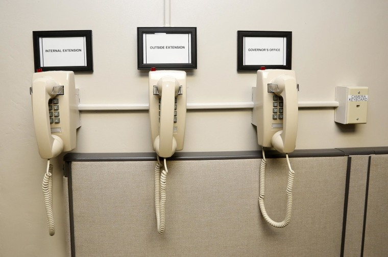 Image: A bank of phones on the wall of the operations room in the newly renovated death chamber