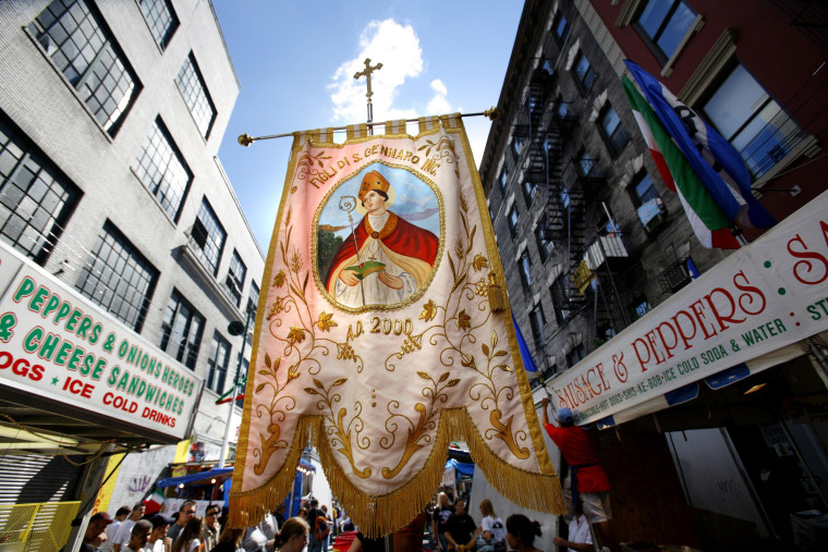 San Gennaro banner carried in New York's Little Italy during 80th Feast of San Gennaro
