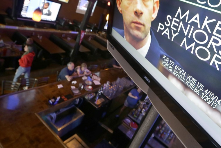 File photo of a political ad on one of the televisions at Gusano's, a downtown Little Rock, Ark., restaurant.