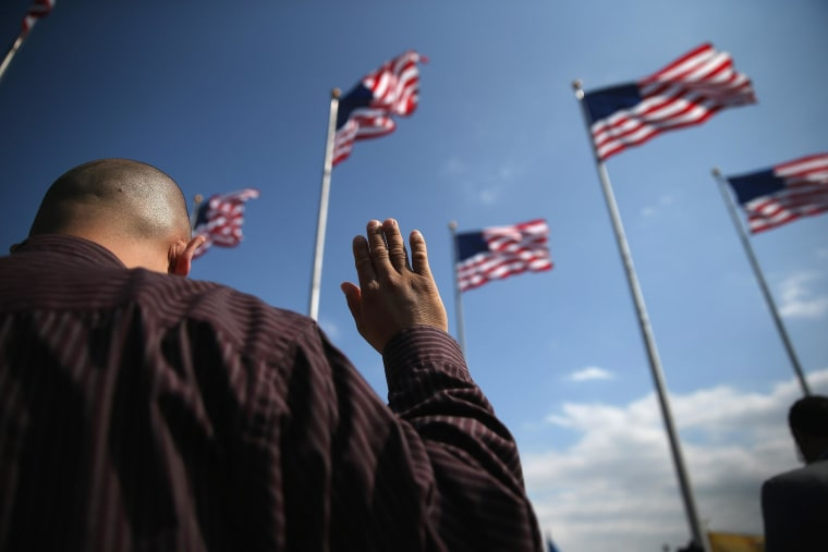 Immigrants take the oath of citizenship to the United States during a naturalization ceremony at Liberty State Park on Sept. 19  in Jersey City, NJ.
