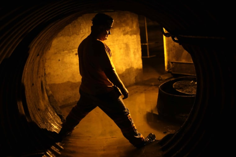Coal miner Mike Hawks, 53, stands in an underground tunnel at a coal processing facility near Gilbert, W. Va., on May 22.