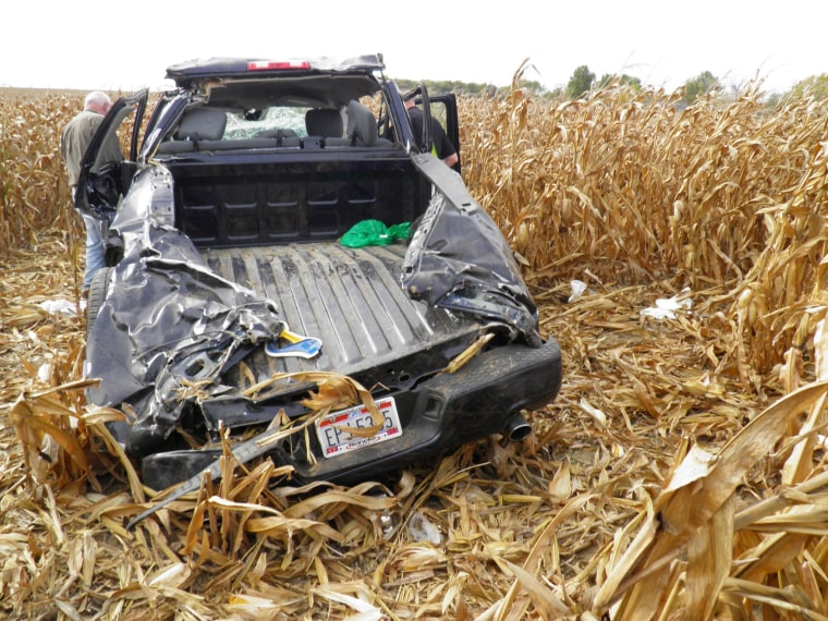 Image: Investigators examine the wreckage of a pickup truck that crashed in a cornfield near Upper Sandusky, Ohio