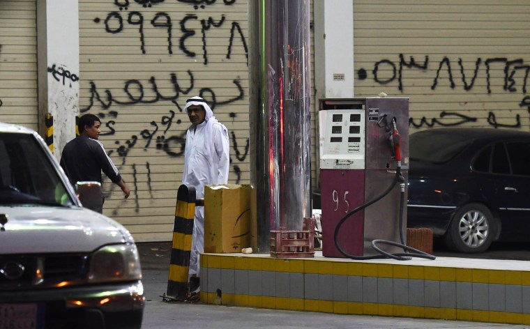 Image: A Saudi man walks at a gas station where a shooting attack took place earlier in the Saudi capital Riyadh,