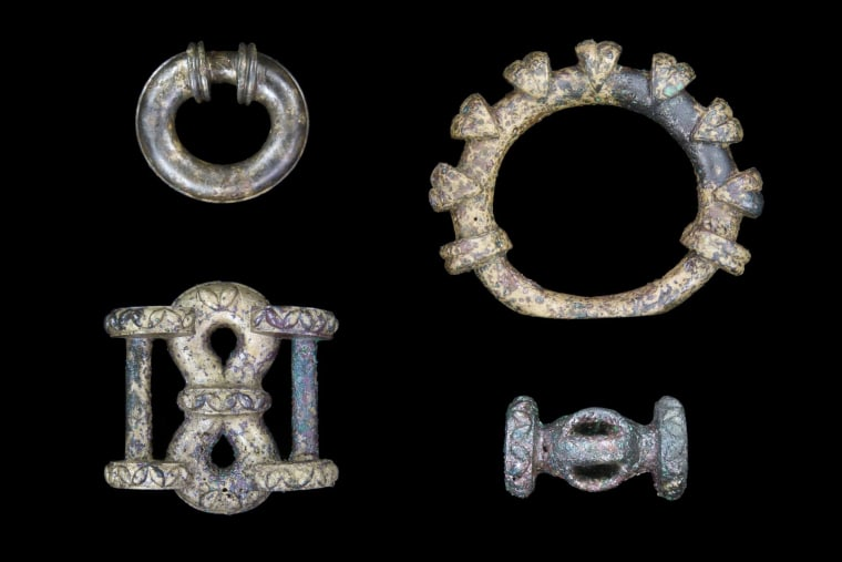Selection of chariot fittings: miniature terret ring (upper left), large terret ring (upper right), strap junction (lower left) and barrel-shaped harness fitting.