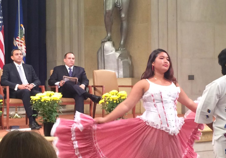 Image: Dancers from Springbook High School in Silver Spring, Maryland perform at a Department of Justice Hispanic Heritage Month event where Associate Deputy Attorney General Armando Bonilla, left, spoke about his immigrant roots
