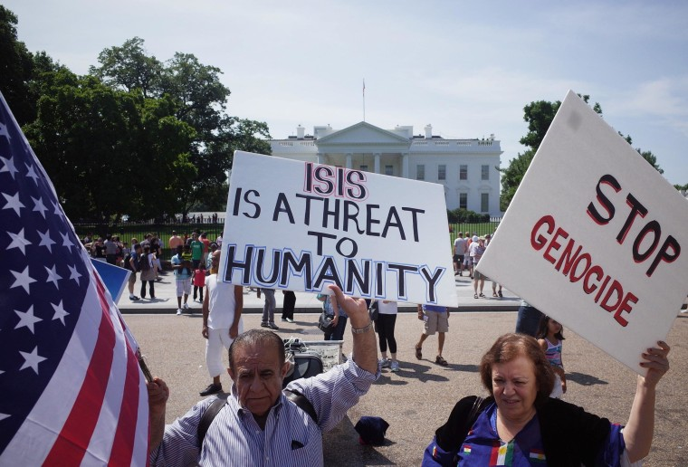 Demonstrators at a rally supporting Kurdistan hold placards protesting against the Islamic State of Iraq and Syria (ISIS) in front of the White House on August 16, 2014.