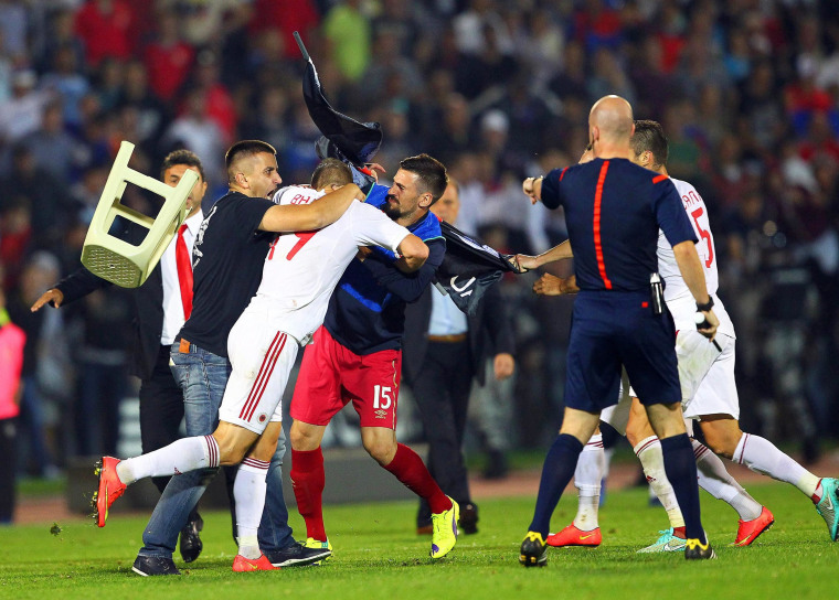 Image: A brawl between players on the pitch during the UEFA EURO 2016 group I qualifying soccer match between Serbia and Albania is suspended in Belgrade, on Oct. 14.