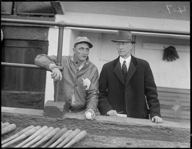 Image: Philadelphia Athletics coach Lena Blackburne, left, with manager Connie Mack