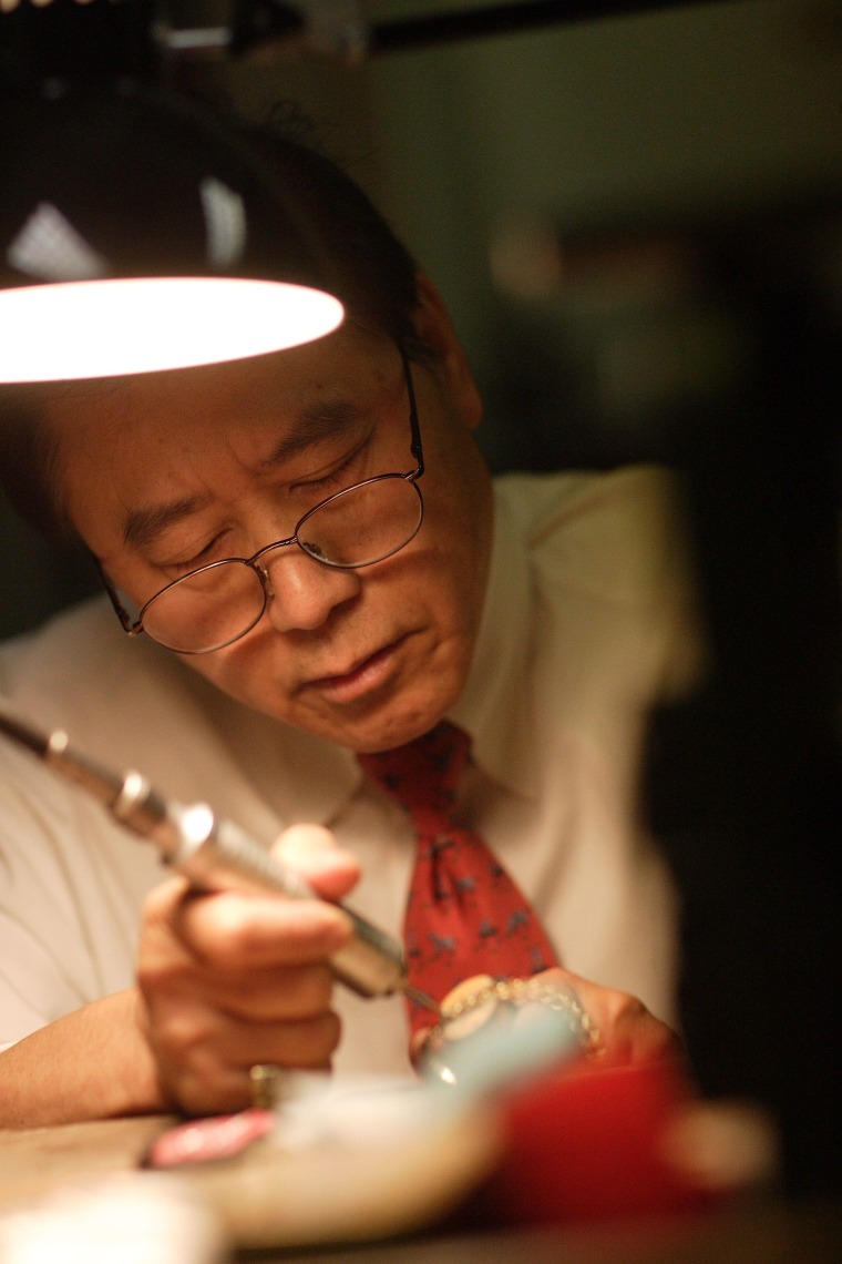 Jimmy Tom, who learned jewelry design from his father, Tom Wing