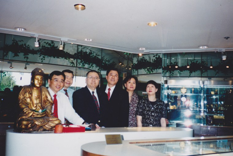 The four sons and two daughters of Tom Wing, in their shop at Stanford Shopping Center, in 2003.
