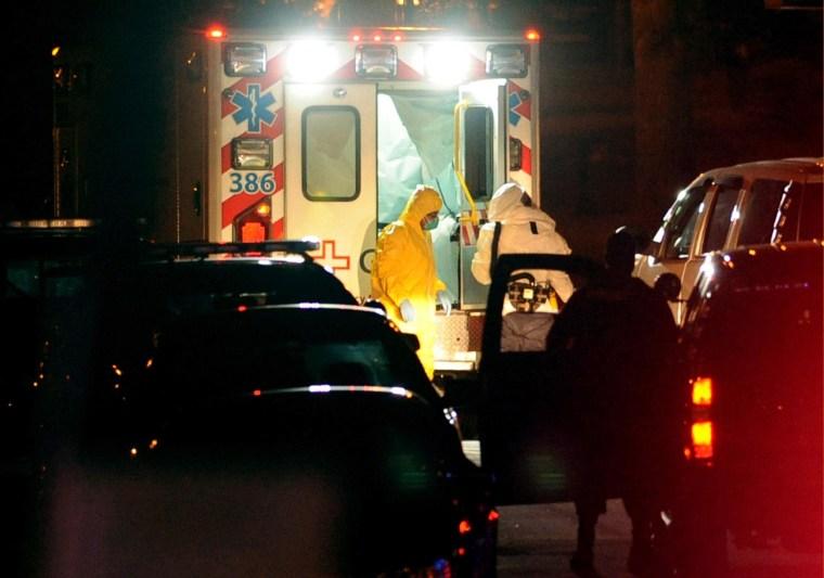 Image: Texas nurse Amber Vinson, left, steps from an ambulance at Emory University Hospital in Atlanta, Georgia