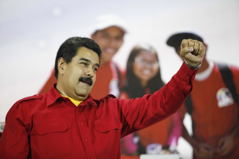 Image: Venezuela's President Nicolas Maduro gestures during a meeting with supporters in Caracas
