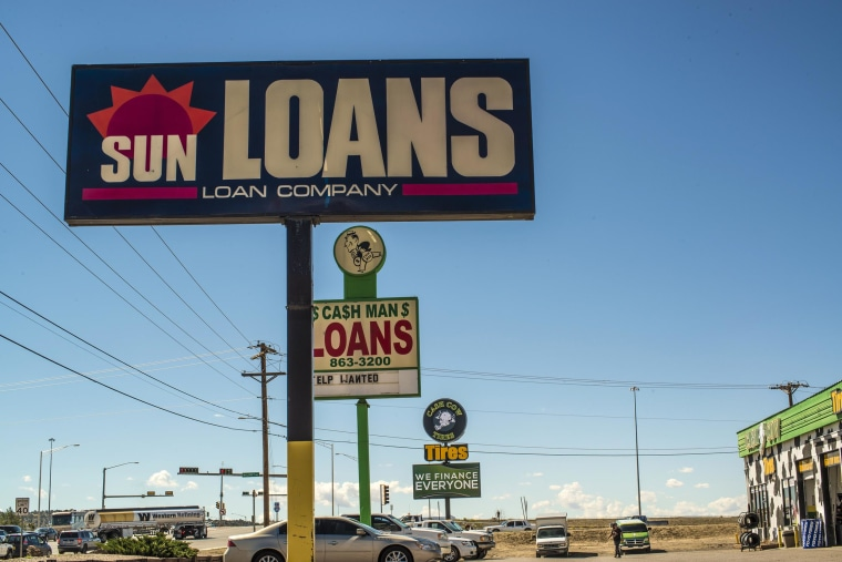 Image: Loan company signs in Gallup, N.M.