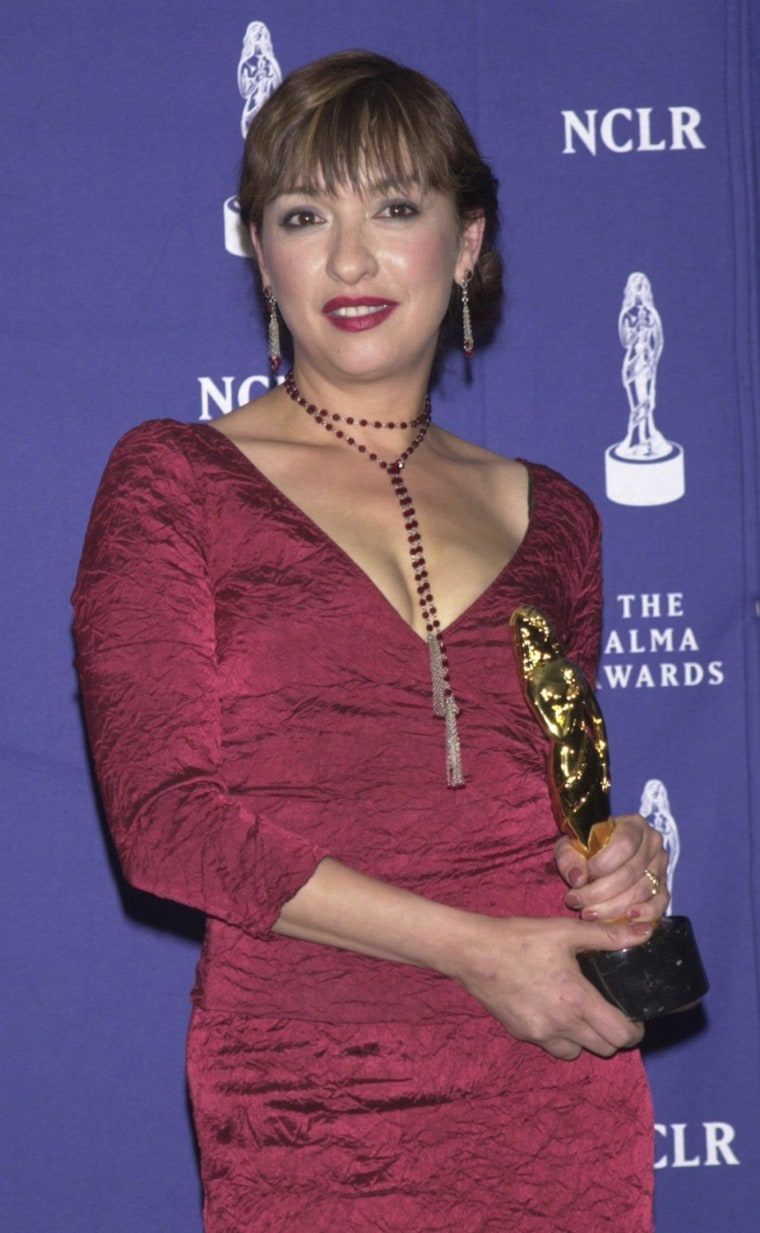 """Image: File photo of actress Elizabeth Pena posing backstage after receiving honors for Outstanding Actress in a New Television Series for """"Resurrection Blvd."""" at the sixth annual American Latino Media Arts (ALMA) Awards in Pasadena, California"""