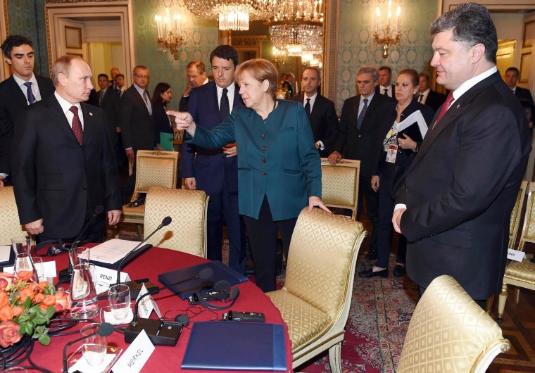 Image: Leaders stand during a meeting on the sidelines of a Europe-Asia summit in Milan
