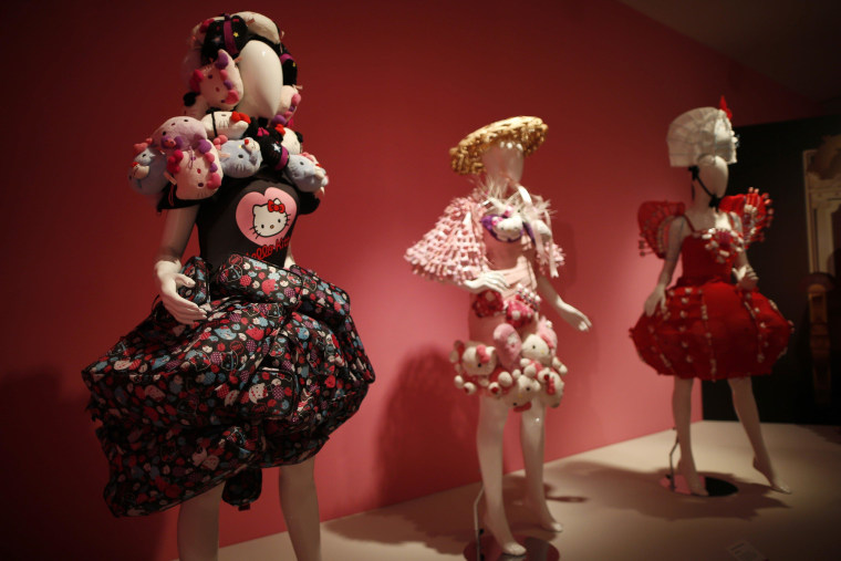 """Image: Hello Kitty dresses are displayed at the """"Hello! Exploring the Supercute World of Hello Kitty"""" museum exhibit in Los Angeles"""