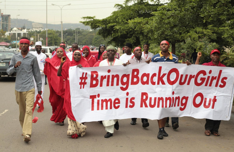 "Image: Campaigners from ""#Bring Back Our Girls"" march during a rally calling for the release of the Abuja school girls who were abducted by Boko Haram militants, in Abuja"