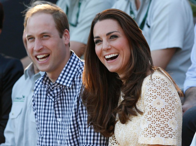 Image: Britain's Prince William and Catherine, Duchess of Cambridge, watching an animal show during their visit to Taronga Zoo in Sydney