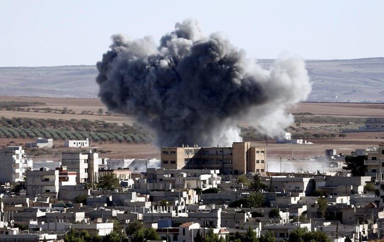 An explosion after an apparent US-led coalition airstrike on Kobani, Syria, seen from the Turkish side of the border, near Suruc district, Sanliurfa, Turkey, 20 October 2014. According to reports, YPG fighters have made gains against IS militants in their defence of the besieged town of Kobane, following over 50 airstrikes around the town carried out by the international anti-IS coalition which according to the Pentagon have killed hundreds of IS militants in the operation now named Inherent Resolve.