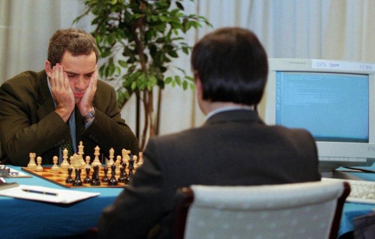 Image: Garry Kasparov, left, reigning world chess champion, matches his genius against IBM's Deep Blue