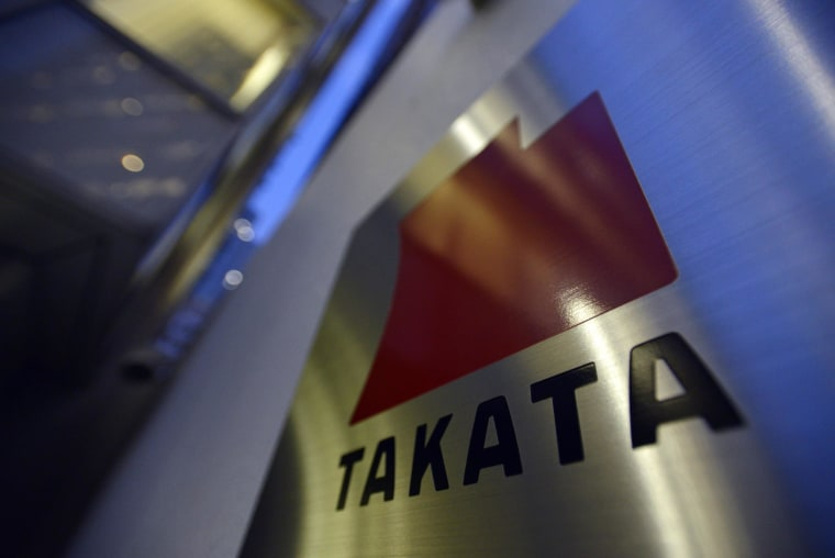 A picture dated 11 April 2013 shows the logo of Japanese auto-parts supplier Takata Corp. at the company Tokyo headquarters in Tokyo, Japan.