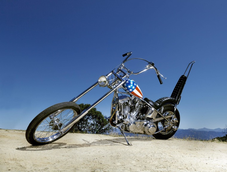 """A star-spangled chopper reportedly ridden by Peter Fonda in the classic film """"Easy Rider"""" sold for $1.35 million, making it one of the most expensive motorcycles ever sold."""