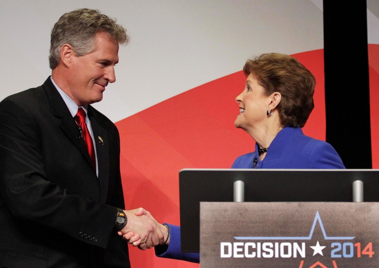 U.S. Sen. Jeanne Shaheen, right, greets Republican challenger Scott Brown before a live televised debate hosted by New England Cable News, the Concord Monitor, and the University of New Hampshire at the Capitol Center for the Arts, on Oct. 21, in Concord, N.H.