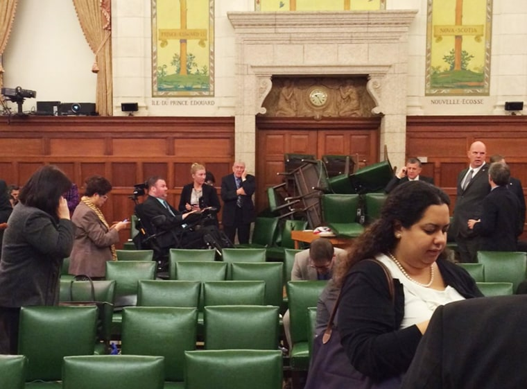 Image: The Conservative Party caucus room is shown shortly after shooting began on Parliament Hill, in Ottawa