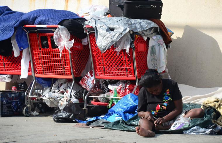 Image: A homeless woman