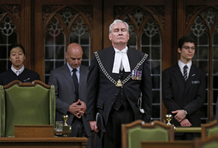 Image: Canada's Sergeant-at-Arms Kevin Vickers is applauded in the House of Commons in Ottawa