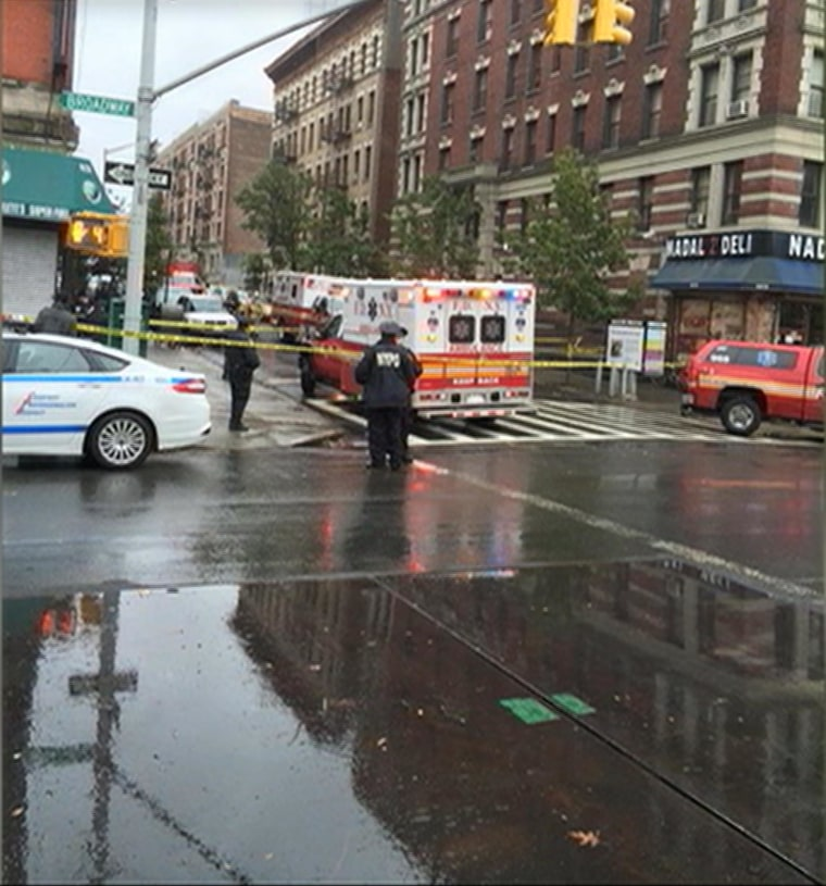 Image: An ambulance and first responders in protective gear responding to the 911 call on 147 Street and Broadway Thursday afternoon.