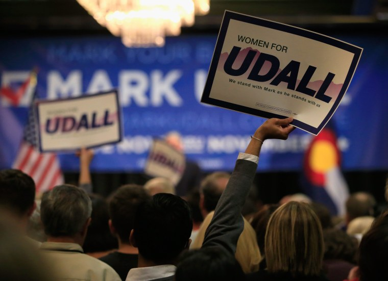 AURORA, CO - OCTOBER 21:  Supporters display signs for U.S. Sen. Mark Udall (D-CO) as he speaks to attendees at a rally on October 21, 2014 in Aurora, Colorado. Former Secretary of State Hillary Clinton, U.S. Sen. Michael Bennet (D-CO), Colorado Gov. John Hickenlooper and Democratic candidate for U.S. Rep. Andrew Romanoff attended the rally for U.S. Sen. Mark Udall (D-CO) ahead of the November 4, 2014 elections.  (Photo by Doug Pensinger/Getty Images)