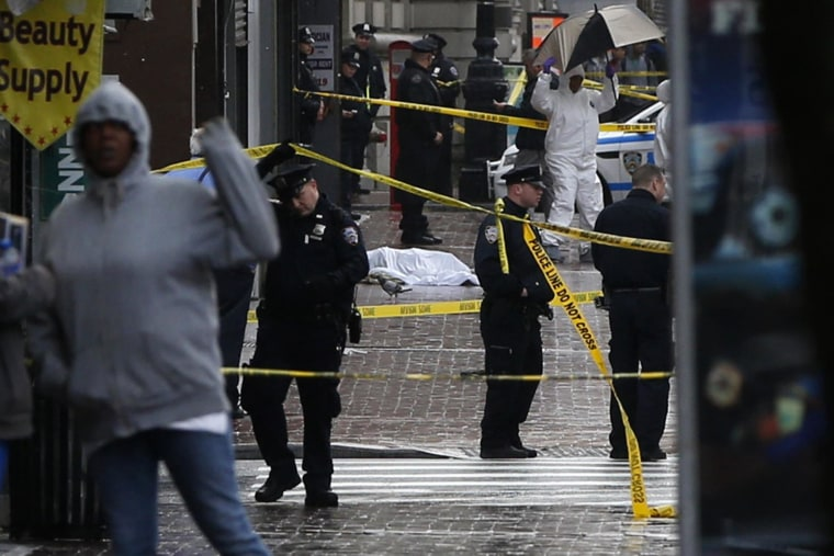 Image: A body lays covered on Jamaica Avenue near 162nd street in the borough of Queens in New York