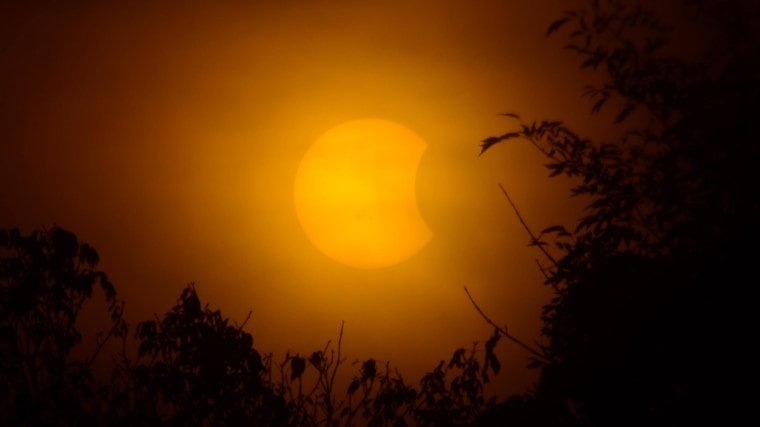 Image: The partial solar eclipse is visible from Louisville, Ky.