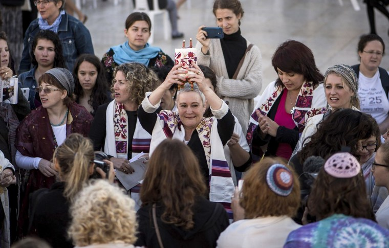 Image: Members of the group 'Women of the Wall' succeed for the first time in smuggling a Torah scroll to the Western Wall