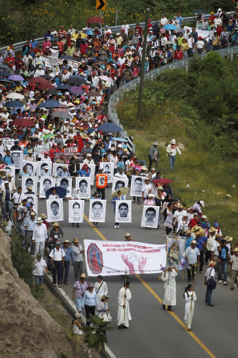 Image: People take part in a demonstration to demand information about missing students, in Chilpancingo