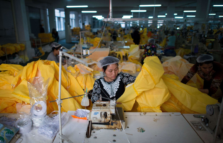 Image: Factory making protective suits for use in handling people infected with the Ebola virus
