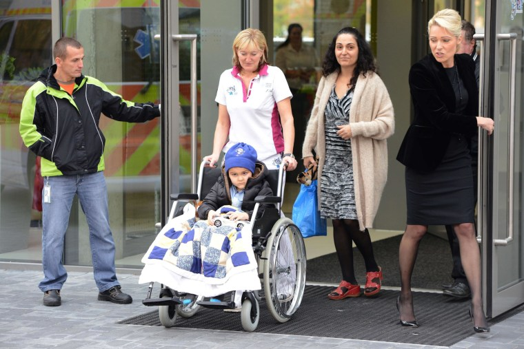 A medic wheels five-year-old Ashya King who suffers from brain tumor to an ambulance car on October 24, 2014 in Prague. Five-year-old British brain tumor patient Ashya King is feeling better after 30 sessions proton therapy in Prague and is now heading back to Spain, his doctor said. King's case made headlines after his parents removed him from a hospital in Britain in August 2014 against doctors' wishes, sparking an international manhunt.