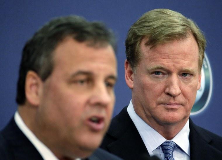 NFL commissioner Roger Goodell, right, listens to New Jersey Gov. Chris Christie speak at an NFL Foundation news conference on Jan 27, in Newark, N.J.