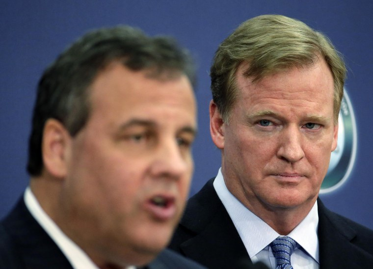 NFL commissioner Roger Goodell, right, listens to New Jersey Gov. Chris Christie speak at an NFL Foundation news conference on Jan 27, in Newark, N.J.