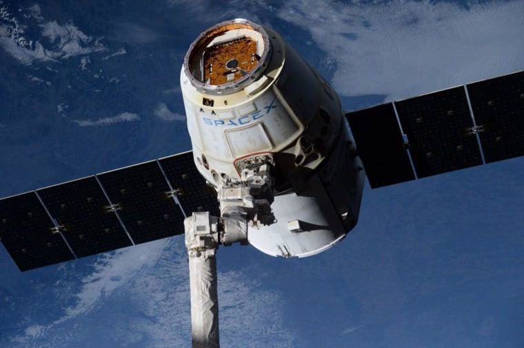 "NASA astronaut Reid Wiseman tweeted this picture from the International Space Station on Saturday. ""A space-weathered SpaceX Dragon looking great moments before release today,"" he wrote."