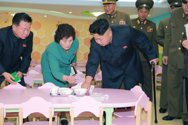 North Korean leader Kim Jong Un gives field guidance during his visit to the completed Pyongyang Baby Home and Orphanage, in this undated photo released by North Korea's Korean Central News Agency (KCNA) in Pyongyang on October 26, 2014. REUTERS/KCNA (NORTH KOREA - Tags: POLITICS)