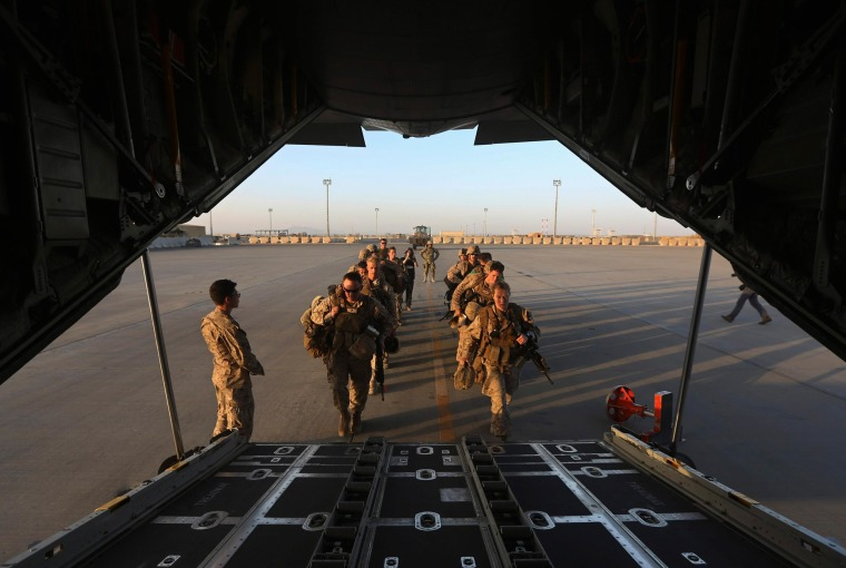 Image: U.S. Marines prepare to board a plane at the end of operations for U.S. Marines and British combat troops in Helmand