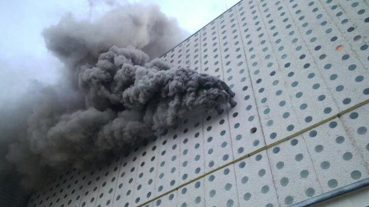 Image: Smoke billows out of the Mexico City Airport on Monday, Oct. 27, 2014.