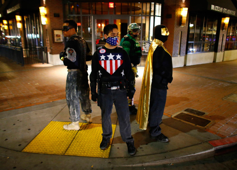 Image: Fallen Boy, Freedom Fighter, Mr. Xtreme and Vortex of the Xtreme Justice League stand watch on a street corner in downtown San Diego,California