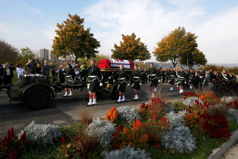 Image: Soldiers escort the coffin during the funeral procession for Cpl. Nathan Cirillo in Hamilton